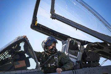 pilot in aircraft cockpit