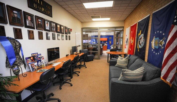 The Hall of Honor and flags of the different branches of service in the VETS Center at Angelo Sta...