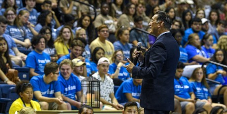 Dr. Javier Flores welcomes new students to campus during  Rambunctious Week