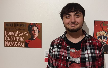 "Zachary Vigil-Minyard with his winning print ""Natalia"""